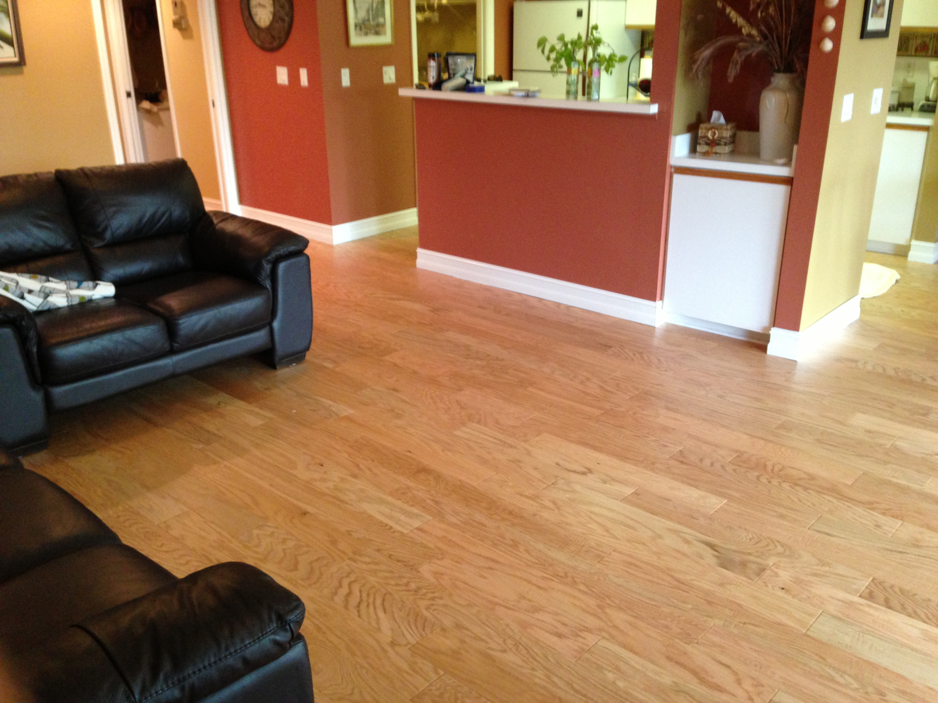Handscraped red oak flooring installed throughout this condo.