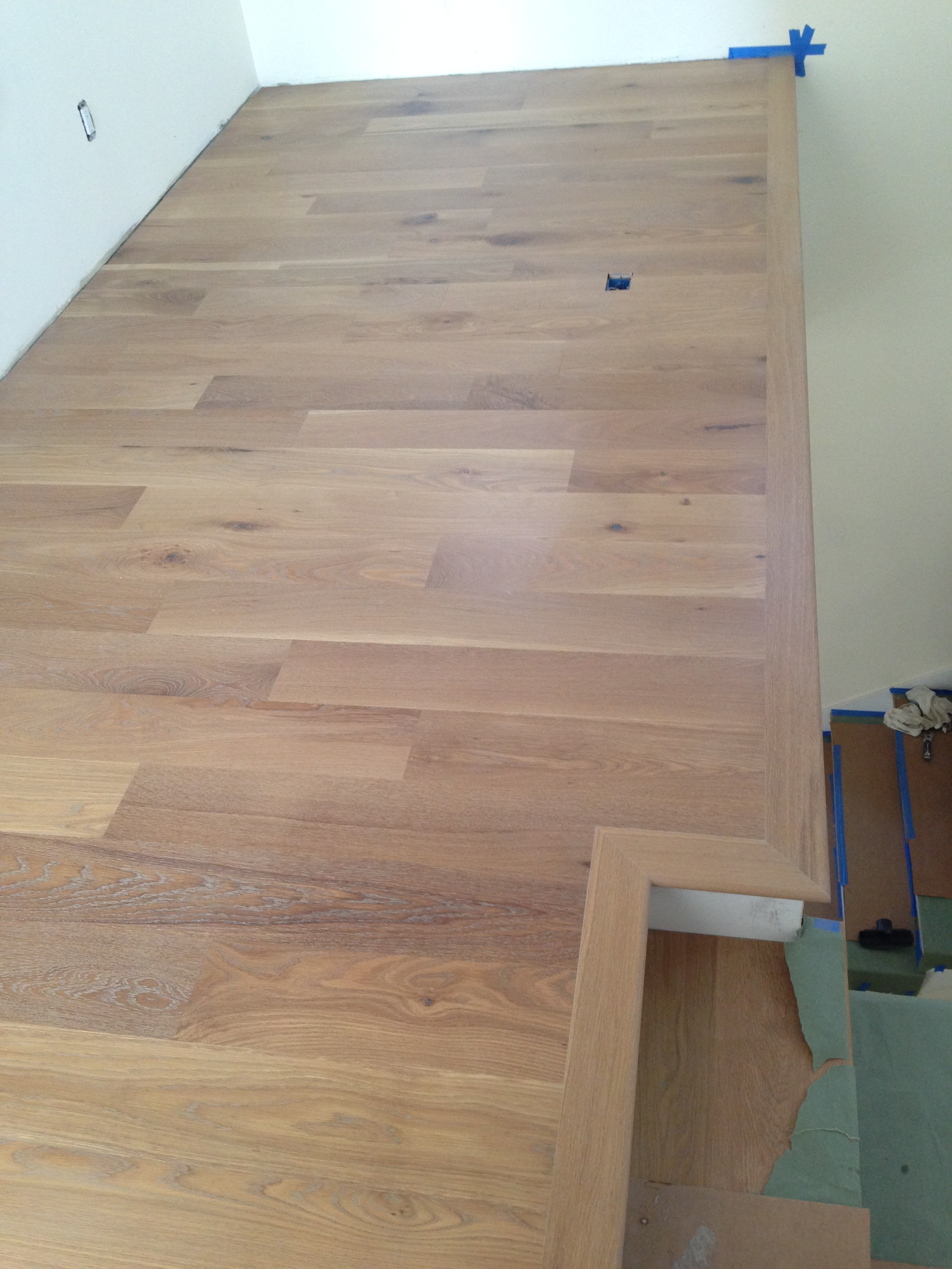 Custom finished white oak floor and stair treads.