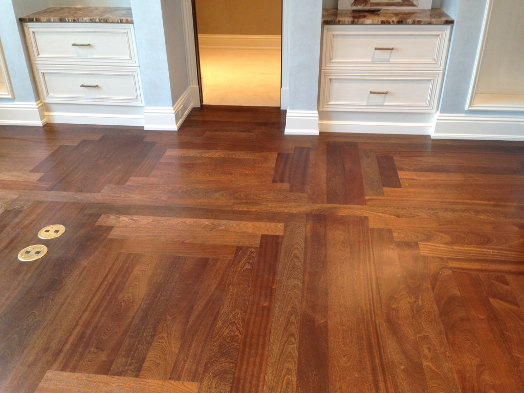 Custom made Pattern and Finish.  African Sapele engineered hardwood.